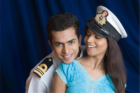 preteen girl boyfriends - Close-up of a navy officer romancing with a teenage girl Stock Photo - Premium Royalty-Free, Code: 630-03479437