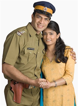 female police officer happy - Portrait of a police officer standing with his arm around his wife Stock Photo - Premium Royalty-Free, Code: 630-03479466