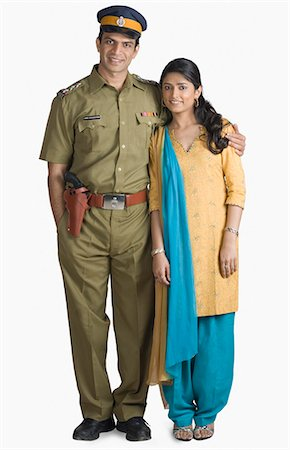 female police officer happy - Portrait of a police officer standing with his arm around his wife Stock Photo - Premium Royalty-Free, Code: 630-03479463