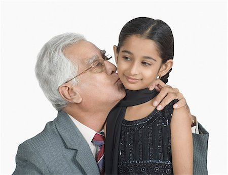 preteen kissing - Close-up of a senior man kissing his granddaughter Stock Photo - Premium Royalty-Free, Code: 630-03479658