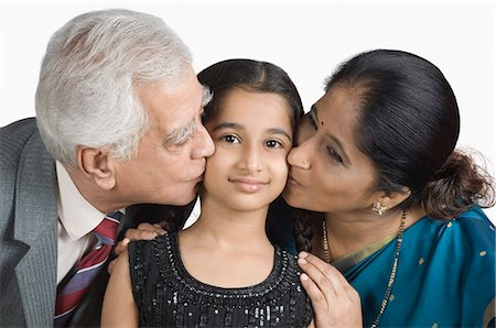 preteen kissing - Senior man and a mature woman kissing their granddaughter Stock Photo - Premium Royalty-Free, Code: 630-03479683