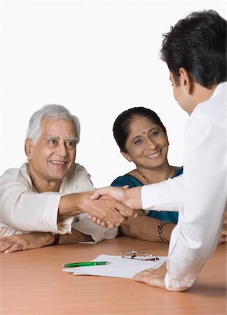 Couple discussing with a financial advisor Stock Photo - Premium Royalty-Free, Code: 630-03479740