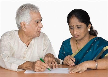 Senior man signing an agreement Stock Photo - Premium Royalty-Free, Code: 630-03479741