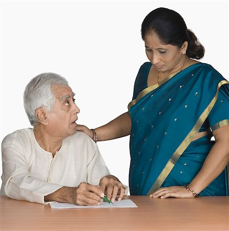 Senior man discussing with his wife Stock Photo - Premium Royalty-Free, Code: 630-03479742