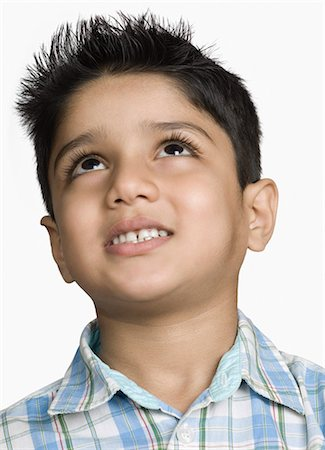 Close-up of a boy day dreaming Stock Photo - Premium Royalty-Free, Code: 630-03479769