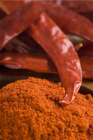 paprika - Close-up of red chili peppers with paprika Stock Photo - Premium Royalty-Free, Code: 630-03480031