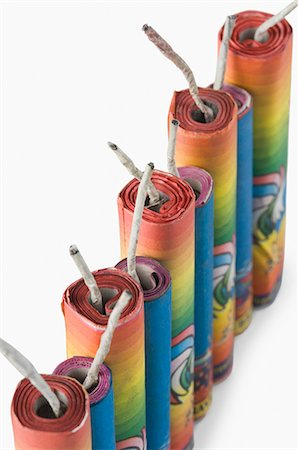 fireworks white background - Close-up of firecrackers in a row Stock Photo - Premium Royalty-Free, Code: 630-03480103