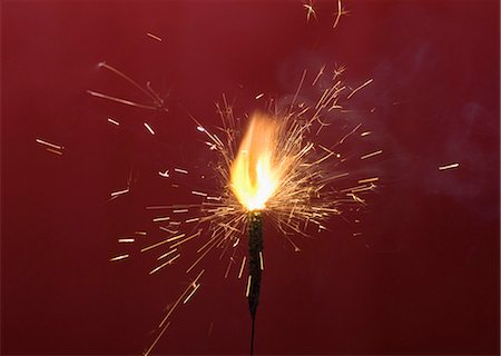 spark - Close-up of a firecracker burning Stock Photo - Premium Royalty-Free, Code: 630-03480175