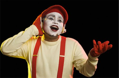 Close-up of a mime wearing a headset and singing Stock Photo - Premium Royalty-Free, Code: 630-03480705