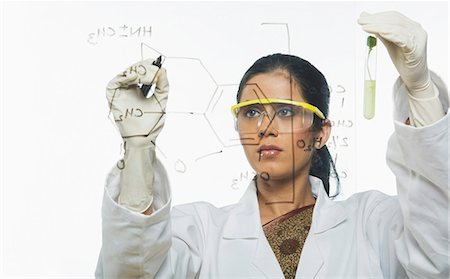 formula - Scientist writing chemical formula Stock Photo - Premium Royalty-Free, Code: 630-03480812