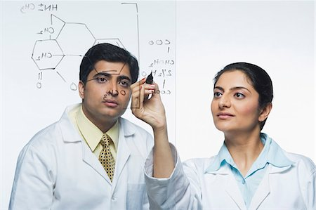 formula - Scientists at work on a problem Stock Photo - Premium Royalty-Free, Code: 630-03480986