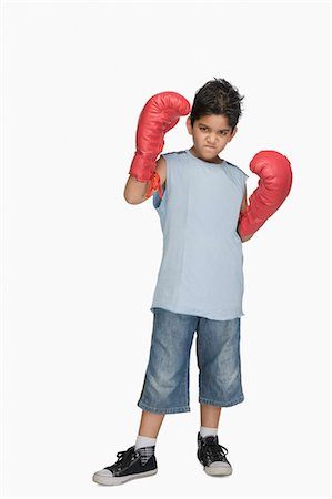 Portrait of a boy wearing boxing gloves Stock Photo - Premium Royalty-Free, Code: 630-03481264