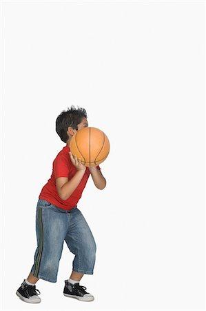 Boy throwing a basketball Stock Photo - Premium Royalty-Free, Code: 630-03481261