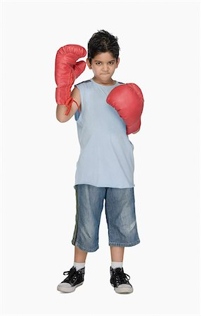 Portrait of a boy wearing boxing gloves Stock Photo - Premium Royalty-Free, Code: 630-03481263