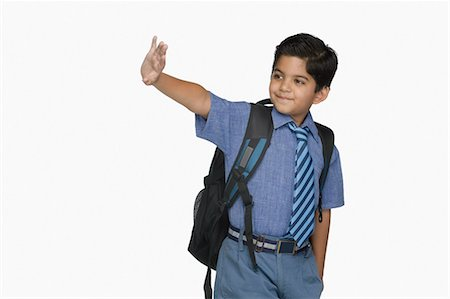 Schoolboy leaving for the school Stock Photo - Premium Royalty-Free, Code: 630-03481288