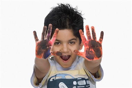 preteens fingering - Portrait of a boy showing his painted hands Stock Photo - Premium Royalty-Free, Code: 630-03481283