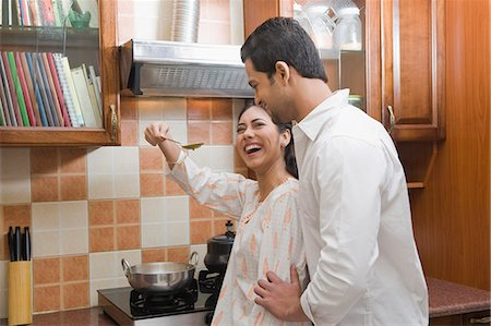 Couple cooking in the kitchen Stock Photo - Premium Royalty-Free, Code: 630-03482598