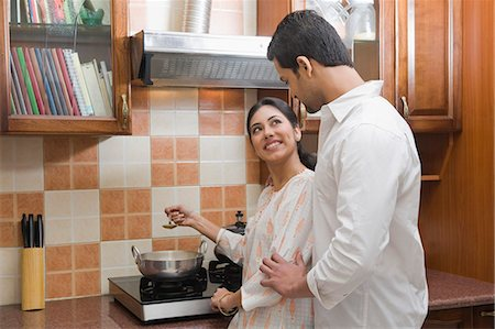 Couple cooking in the kitchen Stock Photo - Premium Royalty-Free, Code: 630-03482600