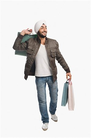 Man carrying shopping bags and smiling Stock Photo - Premium Royalty-Free, Code: 630-03482755