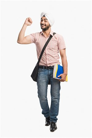 University student holding a book and smiling Stock Photo - Premium Royalty-Free, Code: 630-03482764