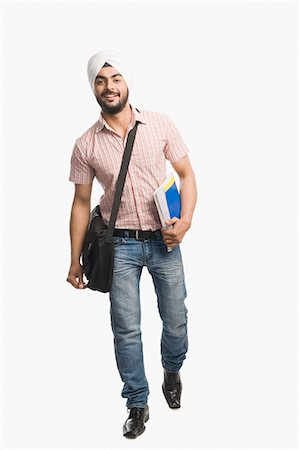 University student holding a book and smiling Stock Photo - Premium Royalty-Free, Code: 630-03482761