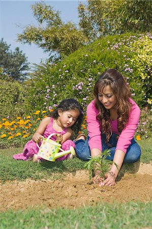 Woman planting with her daughter Stock Photo - Premium Royalty-Free, Code: 630-03483074