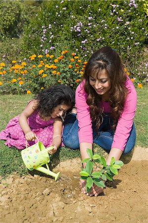 Woman planting with her daughter Stock Photo - Premium Royalty-Free, Code: 630-03483076