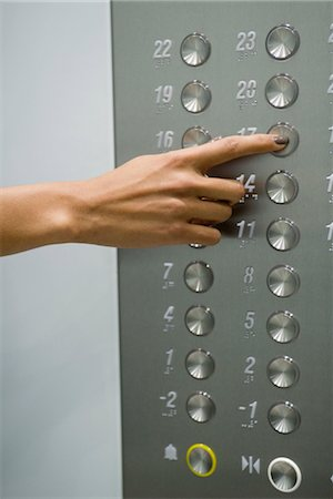 Woman's hand pressing 17 floor button Stock Photo - Premium Royalty-Free, Code: 632-05401000