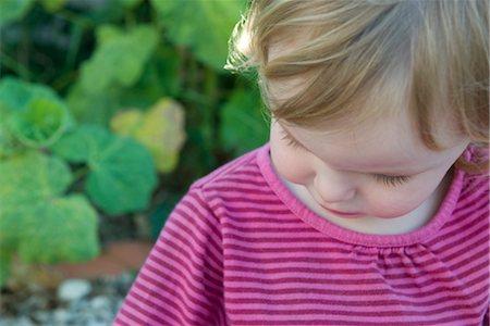 shy baby - Toddler girl looking down Stock Photo - Premium Royalty-Free, Code: 632-05401033