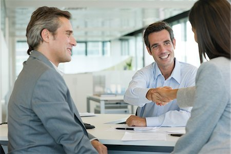 Businessman shaking hands with client Stock Photo - Premium Royalty-Free, Code: 632-05401136