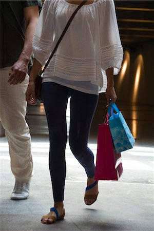 People walking on shopping bags, cropped Stock Photo - Premium Royalty-Free, Code: 632-05401150
