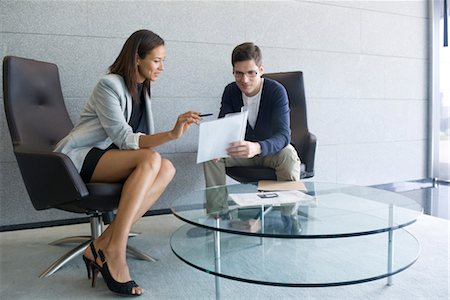 Businesswoman explaining document to client Stock Photo - Premium Royalty-Free, Code: 632-05401168