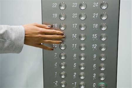 Woman's hand pressing elevator button, cropped Stock Photo - Premium Royalty-Free, Code: 632-05401210