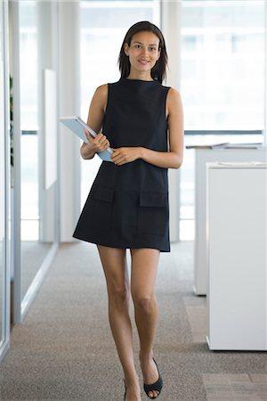 Woman mini skirt Stock Photos - Page 1 : Masterfile
