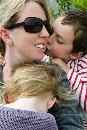 people kissing little boys - Mother with two young children, son kissing her cheek Stock Photo - Premium Royalty-Free, Code: 632-05401253
