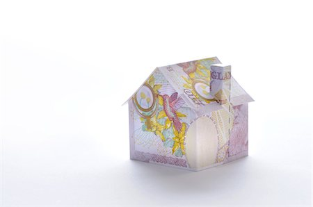 Model house folded with British pound banknote Stock Photo - Premium Royalty-Free, Code: 632-05554000