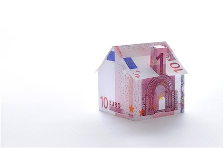 Model house folded with euro banknote Stock Photo - Premium Royalty-Free, Code: 632-05554156