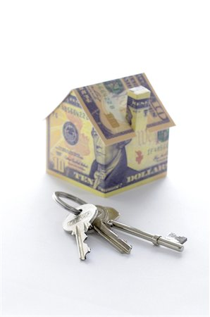 Bunch of keys and model house folded with dollar bills Stock Photo - Premium Royalty-Free, Code: 632-05554174