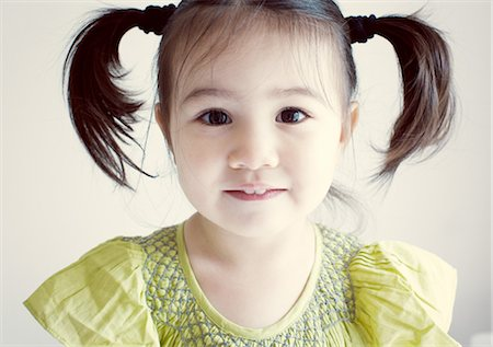 Little girl with pigtails, portrait Stock Photo - Premium Royalty-Free, Code: 632-05553400