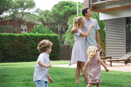 Family relaxing together in backyard Stock Photo - Premium Royalty-Free, Code: 632-05553740