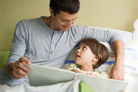 story - Father and son reading book together Stock Photo - Premium Royalty-Free, Code: 632-05553951
