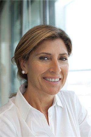 Businesswoman smiling, portrait Stock Photo - Premium Royalty-Free, Code: 632-05604099