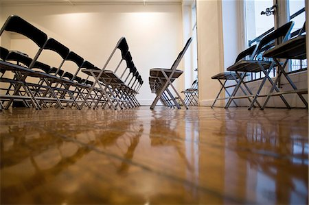 shiny - Folding chairs lined up in empty conference room Stock Photo - Premium Royalty-Free, Code: 632-05604152