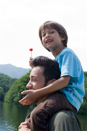 Father carrying son on shoulders Stock Photo - Premium Royalty-Free, Code: 632-05604201