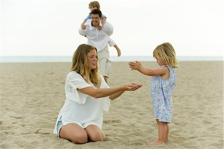 Family playing together at the beach Stock Photo - Premium Royalty-Free, Code: 632-05604221