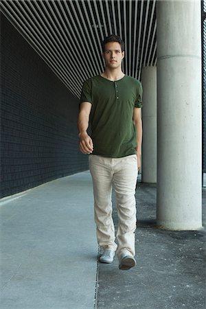 Man walking in outdoor corridor Stock Photo - Premium Royalty-Free, Code: 632-05604236