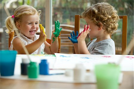 Children finger painting, hands covered in paint Stock Photo - Premium Royalty-Free, Code: 632-05604240