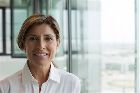 Professional woman smiling Stock Photo - Premium Royalty-Free, Code: 632-05604250