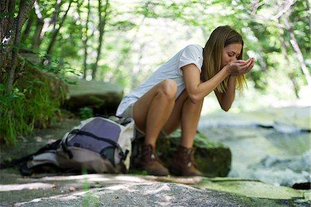 stream - Female hiker drinking water from stream Stock Photo - Premium Royalty-Free, Code: 632-05604251