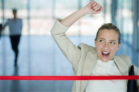 Businesswoman crossing finishing line Stock Photo - Premium Royalty-Free, Code: 632-05604326